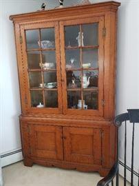 "New England tiger maple corner cupboard; 83"" tall"