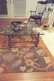glass-top coffee table, rugs & rocking chair