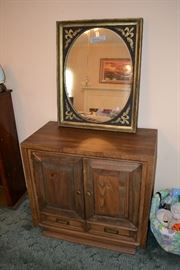 Mid Century cabinet and large heavy mirror with black and gold motif.