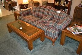 Wood framed couch in excellent condition. Glass top living room table set including coffee table and two side tables.