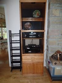 1 of a 4 pc wall united - lights up -- CD//DVD holder (to the left of the cabinet
