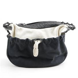 18486b060142 Chanel Black and White Canvas and Leather Handbag: A Chanel handbag in  black and white