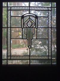 leaded glass set into solid door