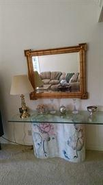 sofa table , wall mirror , brass lamp
