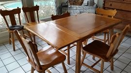 Draw leaf table with six chairs