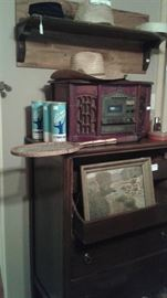 Beautiful shelf with rope trim, replication of antique radio and tennis anyone?