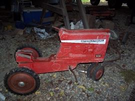 International iron pedal tractor. Needs some love and mending