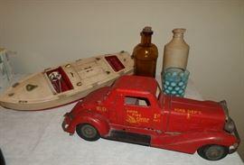 A few antique toys, Louis Marx & Co Fire Truck, Wind-up Speed Boat