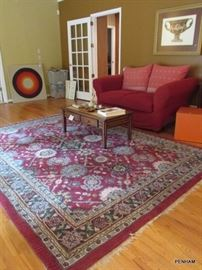 Rugs are for sale too! Very comfortable loveseat...over stuffed.