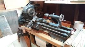 Vintage Craftsman / Atlas Metal Lathe with Wood Bench base and wood Vise. Works great. Includes cutting blades and other accessories.