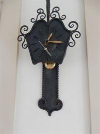 Unusual iron wall clock