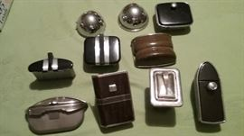 """collection of """"new"""" old automobile ashtrays from the mid 1930's. These were collected by an employee of the factory where they were made. Never installed in a car."""