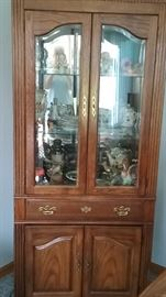 large lighted china / display cupboard. Glass shelves and glass front with storage cabinet below.