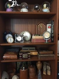 Collectible boxes, stones, clocks