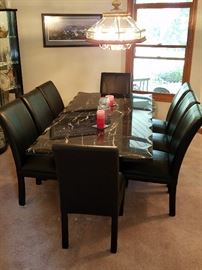Solid Marble diningroom table & 8 leather chairs.