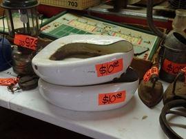Bed pans. Vintage metal football game behind.