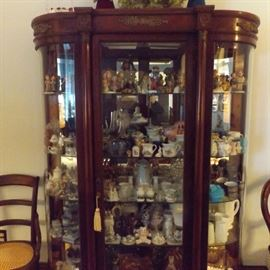 Beautiful bowed glass curio cabinet
