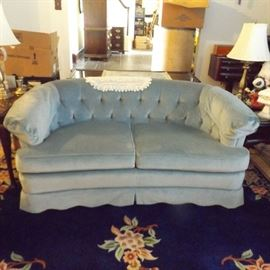 Curved loveseat (same color as couch lighting)