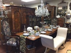 Val-St-Lambert Chandelier, French Provincial Dining Table, Directoire-style Bench, English Burlwood Armoire, Pair of Jacobean-style Armchairs.