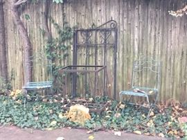 Wrought iron garden furniture and decorative iron pieces and cement statues