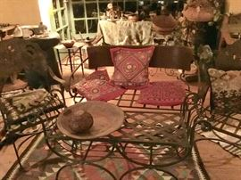 Group of antique wrought iron chairs, loveseat and table. Indian hand stitched pillows, killom rug
