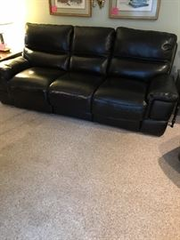 Nice leather couch with electric recliners on each end