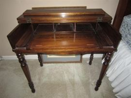 Small spinet desk with pull out writing surface