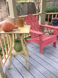 Antique parlor table painted a light yellow and one of two Androndike style chairs