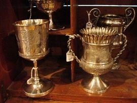 Several loving cups, turn of the century and late 19th century. Silver plate. Small.
