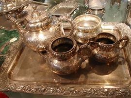 One of several coffee and tea services. None have matching trays, and several do not have trays.