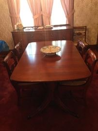 Dining table & chairs...all needlepoint upholstered (Captain's chair included), leaf and pads
