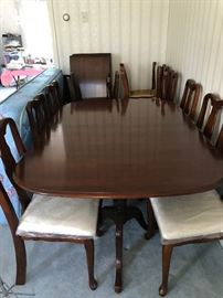 Pennsylvania House 3.  Cherry Wood. Great condition.  A couple small stains and nicks.  12 chairs in excellent condition (still have plastic on cushions).  One chair has spot on finish.  Includes 3 leaves to comfortably fit 12.