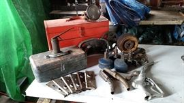 Tool boxes, unusual blue casters with wheel covers, Browning metal pulley and assortment of others, oil can, metal door knob plates, OPW gas pump nozzle and other misc.