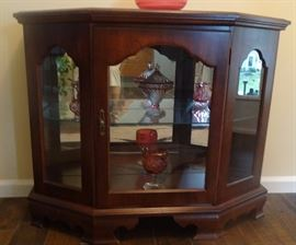 "glass front curio cabinet. 36"" wide x 12"" deep x 29.5"" tall"