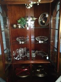 Two-door glass front corner cabinet and serving pieces
