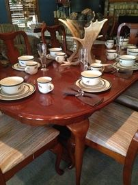 "Dining table and chairs; great ""hunting cabin style"" dishes"