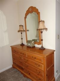 Thomasville dresser and mirror.  Two lamps with feather shades.  Jewelry box with clock.
