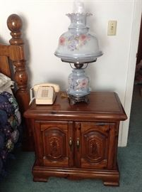 This is one of 2 night stands included in the bedroom set.  Gone with the Wind style lamp. It is a set of 2 and it us new.  Vintage push button phone.