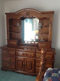 This beautiful dresser and mirror offers plenty of storage for clothes.  There is a light on each side of the mirror.