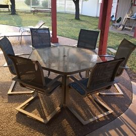 Very nice patio table with eight chairs