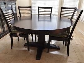 Bassett Black Wood Round Dining Table w/ One Leaf and Six Black Wood Dining Side Chairs w/ Seat Cushions - Table Detail - Round
