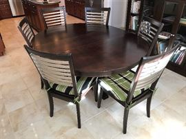 Bassett Black Wood Round Dining Table w/ One Leaf and Six Black Wood Dining Side Chairs w/ Seat Cushions  - Table Detail - w/ Leaf (Oval)