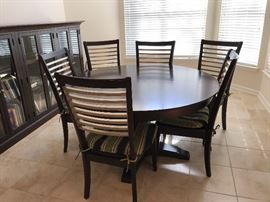 Bassett Black Wood Round Dining Table w/ One Leaf and Six Black Wood Dining Side Chairs w/ Seat Cushions