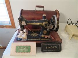 Singer sewing machine with round case and key