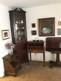 Antiques:   Chippendale glass front corner cabinet-large finial not shown, roll top secretary desk, 1800's swivel gaming table