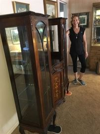 My lovely wife standing next to curio/ sideboard with inlay.