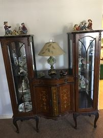 Antique curio sideboard with inlay and carving.