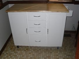 Your kitchen can have additional prep space and storage with this multifunctional kitchen island cart!  An enclosed shelved storage area and towel rack with 4 drawers for more storage. The beautiful and spacious prep surface is complimented by the white cabinet.  Store your mixing bowls, cutting boards, cookbooks, knives.... Makes a great Coffee Bar!