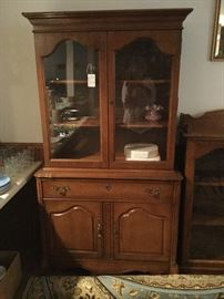 glass and wood cabinet