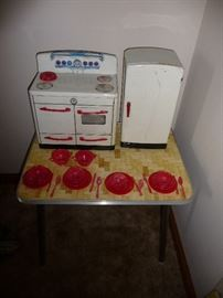 toy stove and refrigerator /dishes